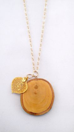 Wood Slice & Yellow Gold Dipped Leaf Necklace by LinzZuelich, $32.00