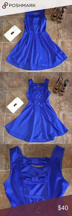 A'GACI Royal Blue Cocktail Dress A'GACI royal blue Cocktail Dress! Excellent used condition! Only worn a couple times. Great comfortable material. Tighter fitting top with loose bottom. Bows crossing open back. Size Small. a'gaci Dresses Mini