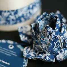 """Origami lotus flower with card attached-  www.withoutahitch.co.uk """"Alternative Wedding Invitations"""""""