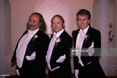 David Crosby, Stephen Stills, and Graham Nash stand together in tuxedos while in Washington, DC.