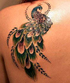 "Peacock tattoo  I want the peacock feathers more detailed, and instead of the designed ""leaves"" I want the zebra striped feathers mixed into it :) ohhhhh yeah! Lol"
