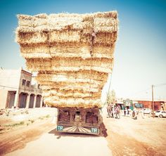 I can't believe this thing has somehow evaded the principals of Newtonian physics! When I pulled into a small kasbah called Aït Benhaddou in the desert to take some photos, I saw this huge truck full of hay rumbling past. I barely kept my wits about me to take a photo just after it passed. - Aït Benhaddou, Morocco - Photo from #treyratcliff Trey Ratcliff at http://www.StuckInCustoms.com
