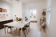 Before & After: A Drab Studio Becomes A Fresh Backdrop for Vibrant Floral Artwork – Design*Sponge Flat Files, Floral Chair, Studio Spaces, Studio Kitchen, Floral Artwork, White Shelves, Painting Studio, Artwork Design, Workspaces