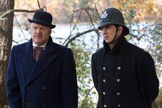 Brackenreid (Thomas Craig) and Crabtree (Jonny Harris) discuss the case.