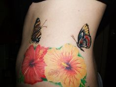 Flower and butterfly rib cage tattoos