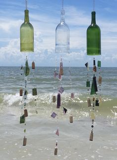 Modified wine bottles, when strung with beautiful pieces of glass, make ornamental wind chimes perfect for inside or out.