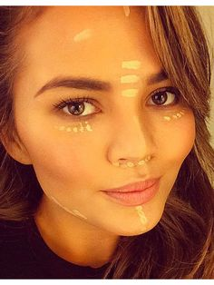 Chrissy Teigen Shows Us Exactly How to Use Face Highlighter http://stylenews.peoplestylewatch.com/2014/11/04/chrissy-teigen-highlighter-makeup-photo/