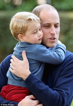 Prince George cuddles with Prince William