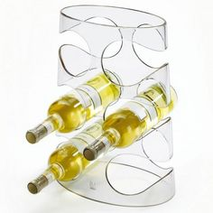 The ideal finishing touch for your contemporary kitchen, this Umbra Grapevine Wine Rack combines a sumptuous blend of swirling and dynamic curves with a visually lightweight & modern material. Modern Wine Rack, Design Transparent, Bar Displays, Wine Display, Kartell, Monochrom, Cuisines Design, Wine Storage, Cool Bars