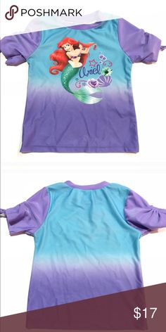 Little mermaid girls swim rash guard •Ariel from Little Mermaid blue and purple short sleeve swim rash guard •Excellent used condition // like new condition  •Size 5 •85% polyester 15% Spandex  ••I am a: Posh Ambassador, top 10% seller, top rated seller, Posh mentor & ship same day/next day!  ⭐️❤️FREE Matching hair accessory with purchase!❤️⭐️ •Comes from smoke & pet free home •Browse my closet for dozen of amazing designers such as.. tucker + Tate, Tea Collection, Mini Boden, UGG, GAP…