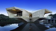 Designed by Charles Wright Architects, the Stamp House in Queensland, Australia, is a self...
