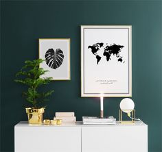 Monstera cheese plant framed artwork for the walls. Map of the world with quote for the avid traveller. Highly polished brass planters and globe table lamps. All complimented with cande light!