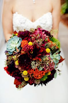 Fall bridal bouquet with gorgeous flower variety: orange cockscomb, burgundy dahlias, succulents, hydrangea, billy balls, etc ~ we ❤ this! moncheribridals.com