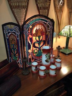 Stained glass fireplace screen attrb George W Maher and cider set with Indian Chief portraits, Christibys