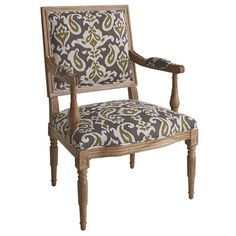 The aristocratic Eliane is a descendant of Louis XVI's classic dining chair. Crafted of solid French oak, this regal armchair features a square back, tight raised seat, corner medallion molding and turned legs. A classic paisley pattern and refined whitewash finish complete the family resemblance.