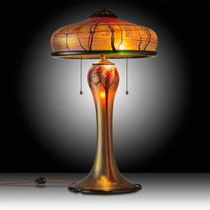 Extra large Luster Art Glass table lamp with a Cherry Blossom design is hand blown by renowned glass artisan Carl Radke.  Each lamp is signed and dated by Radke to assure authenticity and to retain its future collector value. #myOCLlight #oldcalifornia #oldcalifornialighting #craftsmanlighting #madeinamerica #solidbrass #artsandcrafts #lusterglass #tablelamp