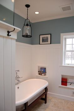 Fairfield Farm Bath remodel, included lots of custom features, recessed niches in the walls, v-groove panel wainscot with ledge, freestanding tub, handheld faucet, and much more! - Laura Vlaming, CKD