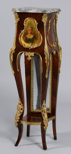 Louis XV style painted pedestal or stand, mixed woods with ormolu mounts, shaped gray and white marble top, over a front panel decorated with a bust length portrait of a blonde lady; inlaid parquetry panelled sides and lower shelf, mirrored back panel; cabriole legs with gilt caryatid mounts to the knees, circa 1900