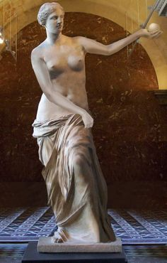 Representation of Aphrodite of Milos,  better known as the Venus de Milo, as she might have appeared before being damaged.  one of the most famous works of ancient Greek sculpture. Created between 130 and 100 BC,  It is a marble sculpture, slightly larger than life size at 203 cm (6 ft 8 in) high. The arms and original plinth were lost following its discovery. From an inscription that was on its plinth, it is thought to be the work of Alexandros of Antioch.