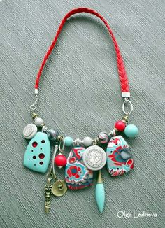 """Bead, wire and leather necklace. I like the """"charm-bracelet"""" like effect"""
