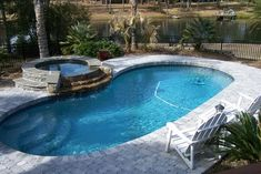Does Your Living Area Extend to Your Backyard? - tropical - pool - other metro - Sharon Mihalsky