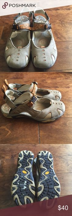 Merrell Tan/orange sandals Has couple of stains on right shoe but other than that's they're in great condition Merrell Shoes Sandals