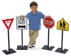 Your kids don't have to ride to know all the safety signs of the road! Teach them the basics in road safety with this set of four road signs! The Angeles Traffic Signs Set 1 features: Includes four au Noah's Park, Outdoor Classroom, Classroom Decor, Outdoor Playground, Playground Ideas, Angeles, Backyard For Kids, Cub Scouts, Kitchen