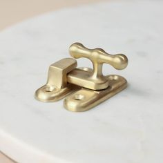 Satin Brass Cupboard Catch made in the UK. Available online here https://www.willowandstone.co.uk/cabinet-knobs-fittings-/satin-brass-cupboard-catch.php