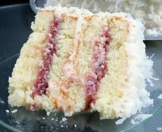coconut cake with raspberry filling omg! Literally my future wedding cake!.