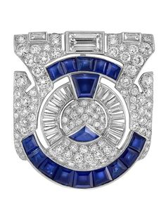 Art Deco Platinum, Diamond and Sapphire Clip-Brooch, Ross-Pennell. The pierced modified shield-shaped mount centring a circular panel, topped and flanked by 3 baguette diamonds, set throughout with 92 round and 16 baguette diamonds, altogether approximately 3.70 cts., embellished by one trapezoid, one triangle and 14 square-cut sapphires approximately 3.65 cts., signed Ross-Pennell, retailer in the 1920s and 1930s on Fifth Avenue, circa 1930.