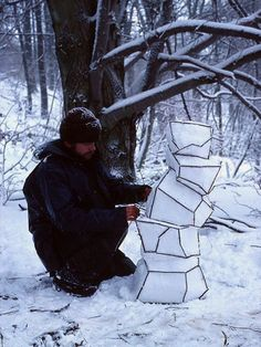 Andy Goldsworthy.  Looks like an abstract snowman to me!  : )