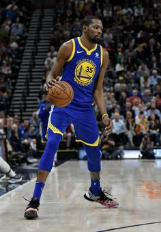 Kevin Durant of the Golden State Warriors controls the ball in the second half of a game against the Utah Jazz at Vivint Smart Home Arena on April 10...