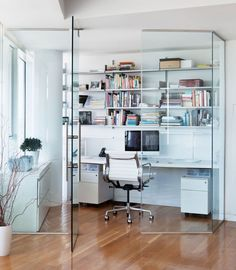 This apartment features a glass enclosed home office space, that keeps sound out, but allows natural light and views in.
