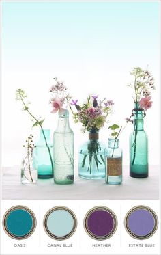 we love the beachy feeling of blue colored glass for florals and decor