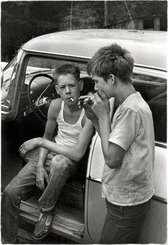 "Leatherwood, Kentucky, 1964. ""Cornett boys smoking by car."""