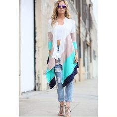 Color block cardigan top 96% polyester 4% spandex. Available in Small, Medium, and Large. Tops