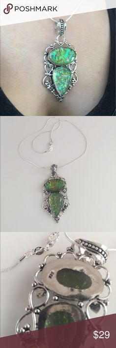.925 GORGEOUS green Gemstone Pendant necklace This new pendant necklace changes colors in every light polished green gemstone is approximately 3 inches in length and 2 inches in width hangs from a .925 silver plated 16 inch chain Jewelry Necklaces