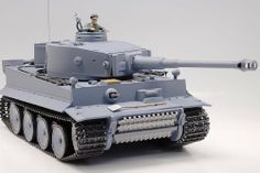 RC German Tiger Tank Remote Control 1:16 by www.RCjo.com. $74.99. Realistic Commander is Equipped  7.2v Rechargable Battery  Powerful Motor  Airsoft Gun (Hop-up system)  3 Channel System  Radio Transmitter  Plastic Pellets Can shoot as far as 25 meters  Auto Reload Bullet System  Excellent Maneuvering Performance  2-Speed System Turret Movement Sideways, Up % Down  Light-Up Warning System  Approximate Operating Time 30 Minutes  Factory Assembled  READY TO RUN  ...