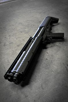 """Kel-Tec KSG The KSG (Kel-Tec Shotgun) is Kel-Tec CNC's first entry into the shotgun market. The size, shape, and design is similar to the currently available Kel-Tec RFB rifle, but the KSG ejects downward, instead of forward. The KSG weighs 6.9 lbs. and is as compact as legally possible with a 26.1"""" overall length and an 18.5"""" cylinder bore barrel. Even with this compact size, the internal dual tube magazines hold an impressive 12 rounds of 12 gauge 3"""" rounds in total (6 per tube)."""
