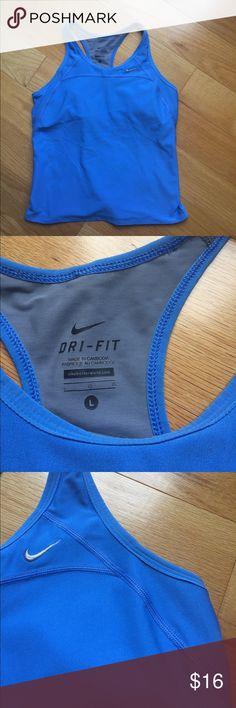 Nike Dri Fit Tank Large, blue Nike Dri Fit Tank Large, baby blue with built in bra Nike Tops Tank Tops