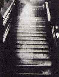 The Brown Lady of Raynham Hall in the famous 1936 photograph.