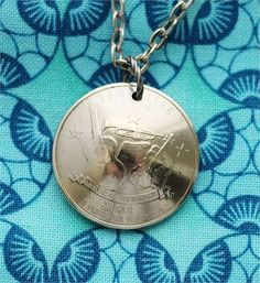 This quarter coin necklace was made from an authentic U.S State quarter coin. The Tennessee state quarter features music and is dated 2002. The quarter has a wonderfully detailed image of a fiddle for bluegrass music, a guitar for country, and a trumpet for the blues.   After I drilled the coin, I cleaned and polished the quarter. Notice that the coin has been domed to add interest. The circulated, domed quarter is 15/16 inch (24mm) in diameter and in excellent condition. It is suspended…