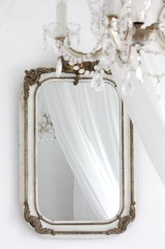 Create your dream room with a dreamy wall mirror.