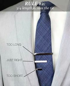 The tie bar should reach about 3/4 of the width of your tie. A little shorter is fine, but the tie bar should never be wider than the necktie.