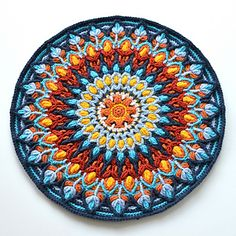 This Mandala was inspired by colorful ceramic plates handmade in Spain. The pattern can be used for making a round pillow cover (with zip) or a separate Mandala, which can be used as a trivet, wall hanging or decoration for fabric pillowcase. You can use Dandelion Border (HERE) or Joana's Border (HERE) to square this mandala up or enlarge into a medium sized rug.