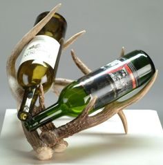 Description: These wine racks are constructed with various sizes of whitetail or mule deer antlers and hold one to three bottles of wine. They are approximately 16 to 20 inches wide and 10 to 12 inches high.  Price: $75 to $100