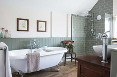 modern meets victorian bathroom; wood-look ceramic floor tiles, green wall tile