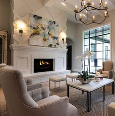 L O V I N G the details on this fire place! I like how this room has a natural color pallet and lets the colorful artwork on the fireplace make the statement.