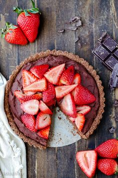This Strawberry Chocolate Tart is filled with whipped vegan chocolate ganache and topped with fresh strawberries in a chocolate crust. Slice into this easy gluten-free, Paleo, and vegan dessert.