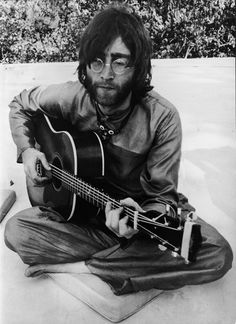 John LENNON playing the guitar in Rishikesh, India where he was following a transcendental course with the rest of the BEATLES members.